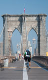 Bicyclist riding though brooklyn bridge Stock Photos