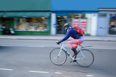 Bicyclist in rush. Person riding bicyclist on the street with blurred background stock photography