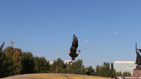 Bicyclist somersaults in air during Big Air Bag jumps championship of Perm region stock video