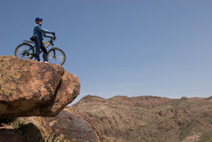 Bicyclist on stone Royalty Free Stock Images