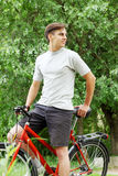 Bicyclist in a summer park Royalty Free Stock Images