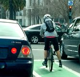 Bicyclist in traffic Stock Photos