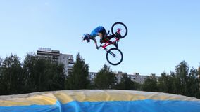 Bicyclist tumbles in air during Big Air Bag jumps championship of Perm region stock video footage
