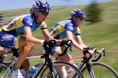 Bicyclists. Two bicyclists race side by side during the 2010 Superior Morgul Classic in Superior, CO Stock Photo