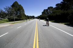 Bicyclists in Golden Gate Park. Wide angle photo of bicyclists in Golden Gate Park, San Francisco, California Stock Image