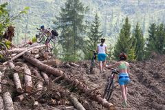 Bicyclists are overcoming difficulties in the mountains.  Royalty Free Stock Images