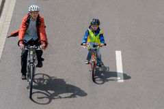 Bicyclists parade in Magdeburg, Germany am 17.06.2017. Father and son are actively involved Royalty Free Stock Image