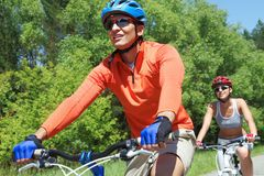 Bicyclists in park Stock Photo