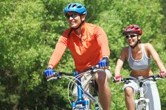 Bicyclists in park Stock Image