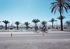 Bicyclists on Paseo Maritimo Stock Photos