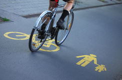 For bicyclists and pedestrians. A bicyclist driving on path for bicyclists and pedestrians Royalty Free Stock Photo