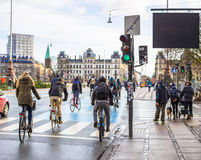 Bicyclists ride on road in Copenhagen. Traffic of bicyclist in european capital in winter Royalty Free Stock Photo