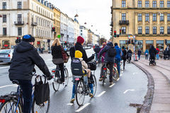 Bicyclists ride on road in Copenhagen. Traffic of bicyclist in european capital in winter Stock Photos