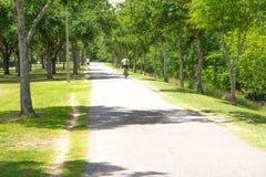 Bicyclists riding on a bike path Stock Photo