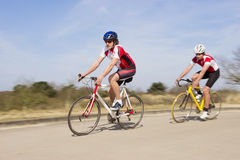 Bicyclists Riding On An Open Country Road Royalty Free Stock Photography