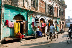 Bicyclists rushing on the narrow street Stock Photos