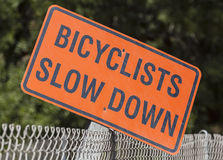 Bicyclists Slow Down Sign Stock Image