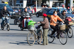 Bicyclists on the street - Beijing, China Stock Photo