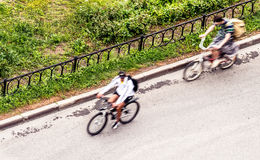 Bicyclists. Various bicyclists at blurry motion Royalty Free Stock Image