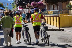 Bicyclists in yellow safety vests Stock Image