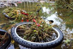 Bicykle and flas flood. Bicykle in water - big flash flood royalty free stock photography