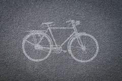 Bicyklu znak na rowerowym pasie ruchu Obrazy Royalty Free