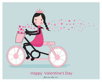 乘坐与心脏的逗人喜爱的女孩一bicyle 免版税图库摄影