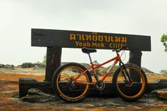 The bicyle is in front of signage. royalty free stock photo
