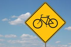Bicyles Ahead Warning Sign. Bicycles ahead warning sign with clouds in the background Stock Photos
