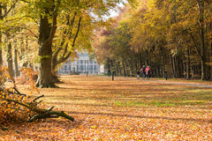 Bicylists near Groeneveld Castle in autumn, Netherlands Stock Photography