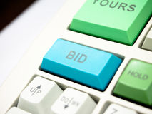 Bid button. Key on investment keyboard stock images