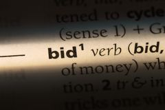 Bid. Word in a dictionary.  concept royalty free stock images