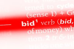 Bid. Word in a dictionary.  concept royalty free stock image