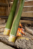 Bidayuh of Sarawak Borneo Cooking Utensil. Close up of bamboo sticks over firewood kitchen. Bidayuh/Land Dayak tribe use bamboo stick for cooking rice, meat or royalty free stock photography