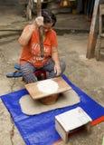 Bidayuh women of Sarawak Borneo. SARAWAK, MALAYSIA - JUNE 2: Unidentified Bidayuh women pounding glutinous rice using traditional rice pounder on June 2, 2014 in Royalty Free Stock Image