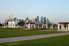 Bidda Park in Doha, Qatar. BIDDA PARK, Doha, Qatar - March 21, 2018: View of buildings in the newly opened Bidda Park in the centre of Qatar`s capital, with Doha royalty free stock photos