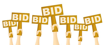 Bidders. Hands holding BID sign to buy from auction Stock Photography