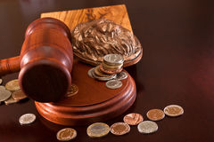 Bidding at auction. Hammer auction, bas a lion's head, and coins of the world Royalty Free Stock Photography