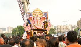 Bidding farewell to Lord Ganesha. Idol of Lord Ganesha being taken in a farewell ceremony  in the city of Mumbai , for submerging the same in a lake , as per Stock Image