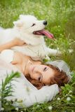 Bride with Samoyed Stock Photo