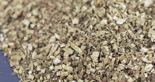 Bidens tripartita in bulk. Dry grass in bulk dry in slices stock video