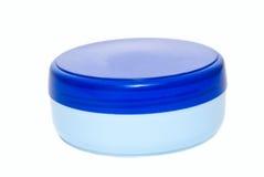 Bidon en plastique bleu de crème Images stock