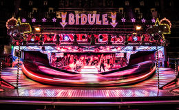 Bidule carousel spinning at night on a fair Stock Images