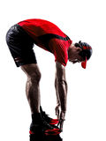 Biegaczów joggers rozciąga rozgrzewkowe up sylwetki obrazy royalty free