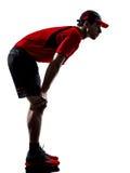 Biegaczów joggers zmęczonego skołowania upału zadyszane sylwetki zdjęcia stock
