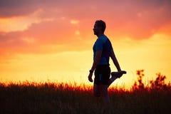 Biegacz przy zmierzchem Zdjęcie Stock