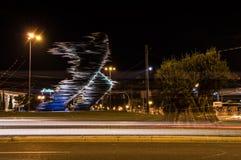 Biegacz statua w Ateny przy nocą Zdjęcie Royalty Free