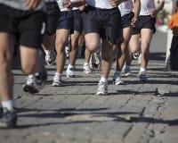 Biegacze na ulicie Obrazy Stock