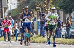 Biegacze Uczestniczy w kompanach Maratońskich w Południowa Afryka obrazy royalty free