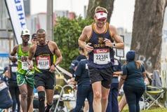 Biegacze Uczestniczy w kompanach Maratońskich w Południowa Afryka fotografia royalty free